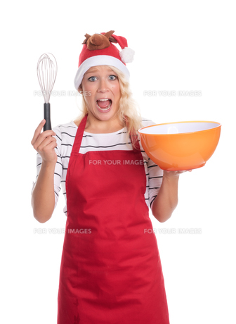 excited christmas woman in apron holding a bowl and a whiskの写真素材 [FYI00787441]
