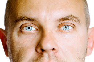 blue-eyed man. The face close up. Studio. isolatedの写真素材 [FYI00787598]