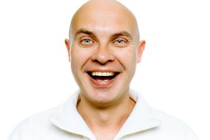 Bald smiling blue-eyed man. Studio. isolatedの写真素材 [FYI00787652]