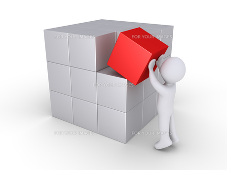 Person finalizing cube constructionの写真素材 [FYI00787886]