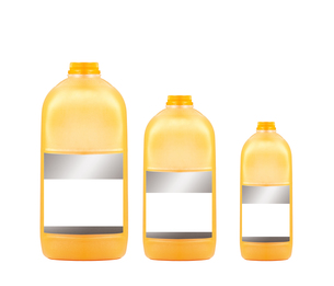 Three orange juice bottles isolated on white backgroundの写真素材 [FYI00789309]