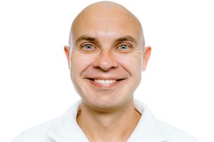 Bald smiling man. Isolated. Studioの写真素材 [FYI00789384]