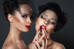 Lure. Two seductive Women with Cherry Berriesの写真素材 [FYI00789856]