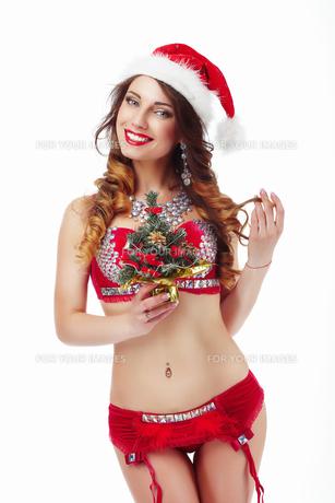 Xmas. Funny Snow-Maiden in Santa Claus Costumeの写真素材 [FYI00789871]