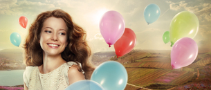 Holiday. Happy Woman with Colorful Air Balloonsの写真素材 [FYI00789927]