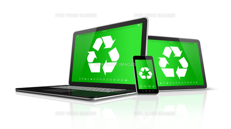 Laptop tablet PC and smartphone with a recycling symbol on screen. environmental conservation conceptの写真素材 [FYI00790208]