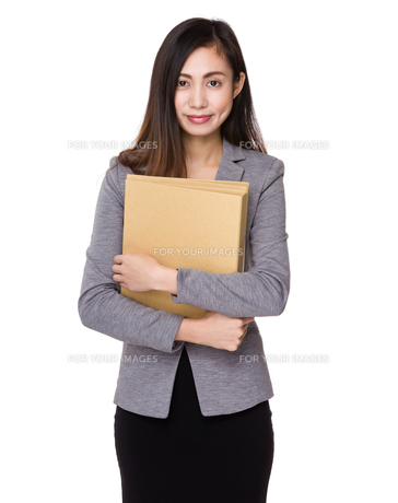 Businesswoman hold with document workの写真素材 [FYI00791491]