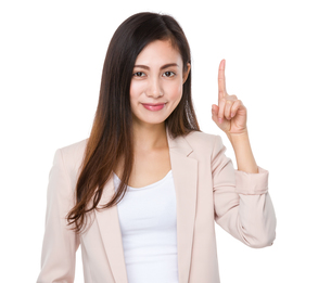 Businesswoman with finger point upの素材 [FYI00791537]