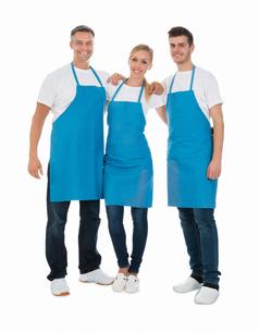 Janitors Wearing Blue Apronの写真素材 [FYI00791849]