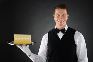 Waiter With Star Rating Boardの写真素材 [FYI00791977]