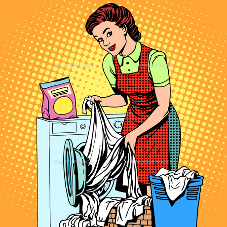 woman washes clothes washing machineの写真素材 [FYI00792390]