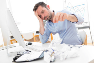 Young attractive man too tired to workの写真素材 [FYI00792524]