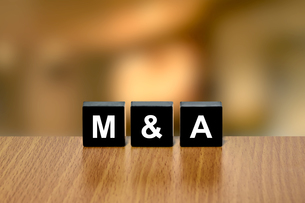 M&A or merger and acquisition on black blockの素材 [FYI00792760]