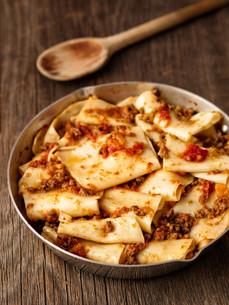rustic italian pasta in ragu sauceの写真素材 [FYI00792947]
