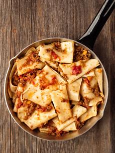 rustic italian pasta in ragu sauceの写真素材 [FYI00792950]