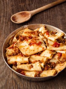 rustic italian pasta in ragu sauceの写真素材 [FYI00792955]