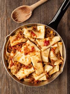 rustic italian pasta in ragu sauceの写真素材 [FYI00792970]
