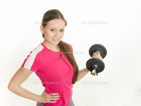 Self-confident athlete with dumbbells in handの写真素材 [FYI00792996]