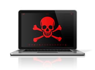 Laptop with a pirate symbol on screen. Hacker conceptの写真素材 [FYI00793415]