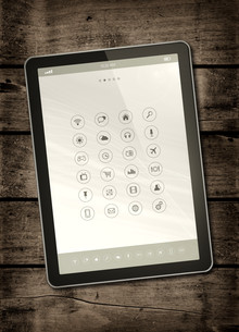 Digital tablet PC on a dark wood tableの写真素材 [FYI00793455]