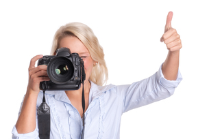 photographer with camera showing thumbs upの写真素材 [FYI00794201]