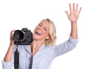 laughing photographer raises his handの写真素材 [FYI00794213]