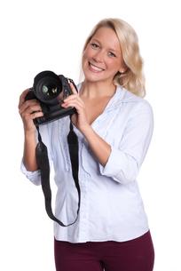 photographer holds an slrの写真素材 [FYI00794219]