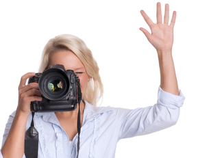 photographer with camera holding up a handの写真素材 [FYI00794222]