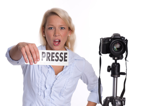 vigorously press photographer with a camera holding a press badgeの写真素材 [FYI00794255]