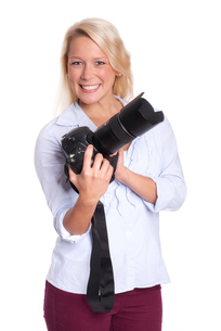 blond woman holding a cameraの写真素材 [FYI00794260]