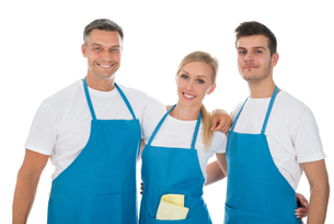 Janitors Wearing Blue Apronの写真素材 [FYI00794620]