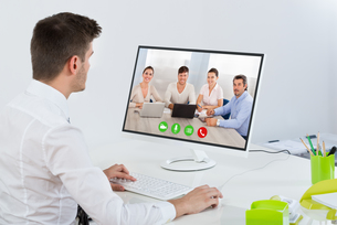 Businessman Videoconferencing With Colleaguesの写真素材 [FYI00794671]