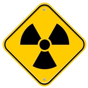 yellow warning sign with symbol for radioactive straの写真素材 [FYI00803926]
