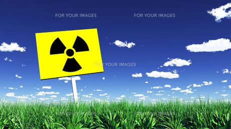 radioactive sign in green grass 01の素材 [FYI00804492]