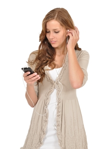 student listens to music from your smartphoneの写真素材 [FYI00813242]