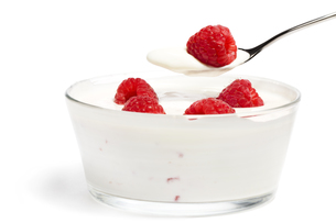 raspberry dessert on a spoon with yogurt over aの写真素材 [FYI00816401]