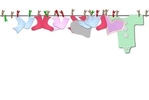 baby bodysuits on the clotheslineの写真素材 [FYI00816688]