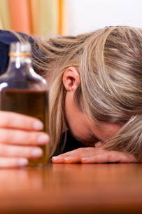 alcohol and abuse - woman drinking too much brandyの写真素材 [FYI00820334]