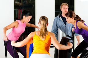 women and trainer in gym before training machineの写真素材 [FYI00820853]