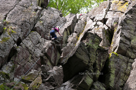 climbing on the stone wall,rhoen,hesse,germanyの写真素材 [FYI00831753]