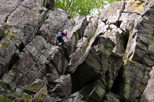 climbing on the stone wall,rhoen,hesse,germanyの写真素材 [FYI00831753]