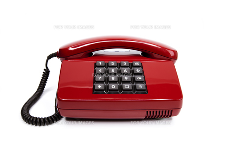 classic red telephone from the eightiesの写真素材 [FYI00833334]