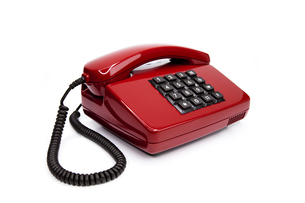classic red telephone from the eightiesの写真素材 [FYI00833336]