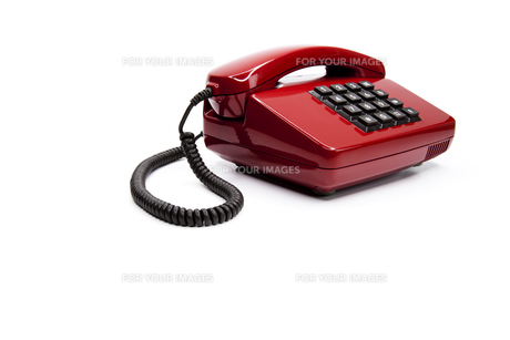 classic red telephone from the eightiesの写真素材 [FYI00833359]