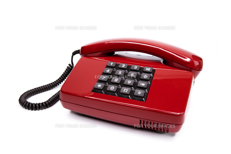 classic red telephone from the eightiesの写真素材 [FYI00833436]