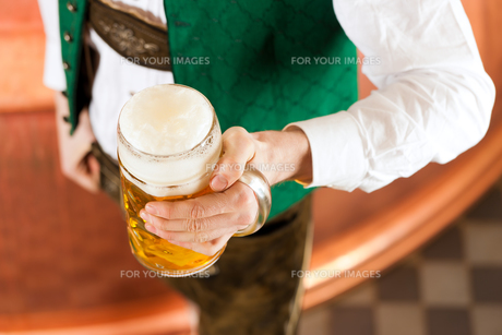 man in costume with beer glass in breweryの写真素材 [FYI00837621]
