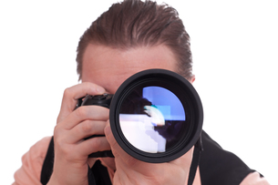 photographer with camera and telephoto lensの写真素材 [FYI00838479]