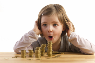 girl is amazed about moneyの写真素材 [FYI00838579]