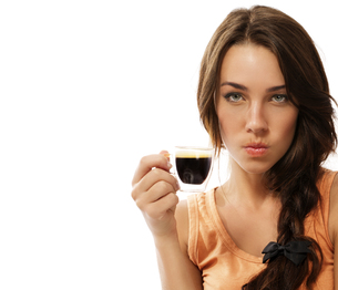 angry young woman with a cup of espresso coffeeの写真素材 [FYI00839665]