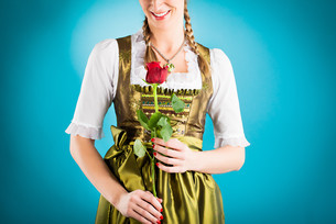 young woman in traditional dirndl or costumesの写真素材 [FYI00840093]